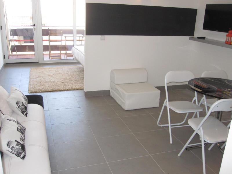 view of the living room leading to bedroom and balcony - Affordable Luxury Condo in Prime Vilamoura Location - Vilamoura - rentals