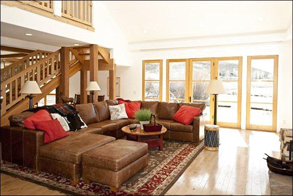 Sunny Living Room Features Cathedral Ceilings, a Fireplace, and Flat-Screen TV - Located on 2.5 Acres - Stunning Mountain Views (1233) - Ketchum - rentals