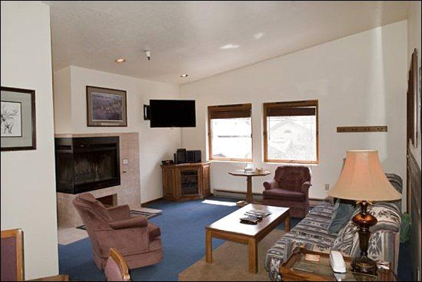 Living Room Features a Gas Fireplace, Flat-Screen TV, and Sleeper Sofa - Cute, Top-Floor Corner Unit - Close to Downtown (1235) - Ketchum - rentals