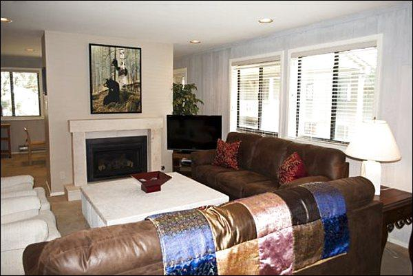 Spacious Living Room Features a Gas Fireplace and Flat-Screen TV - Charming, Remodeled Condo - Bright & Sunny Corner Unit (1242) - Ketchum - rentals