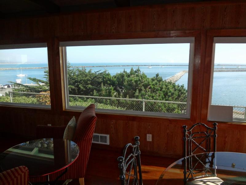 The lovely view out of the dining and living areas. - Quaint Home overlooking Princeton Harbor - El Granada - rentals