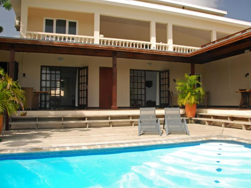 View from our pool at apartment 2 (right door) - Curavilla | Luxurious double apartment & pool, 2 - Willemstad - rentals