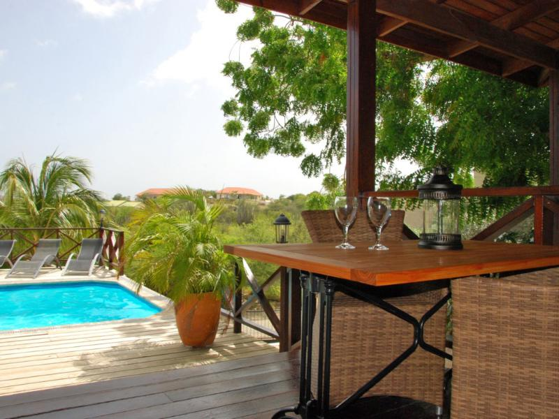 View from apartment 1 overlooking our pool - Curavilla | Luxurious double apartment & pool, 1 - Willemstad - rentals