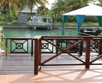 Lovely two tier deck facing west - Palm Breezes - close to beach (new reno) 245D - Jolly Harbour - rentals