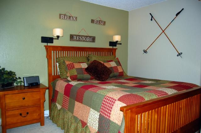 Queen bedroom with bedside lights - perfect for snuggling up with a book - 5-Star - 2 Br/2 Ba Peak 8 Ski Condo for 6, Netflix - Breckenridge - rentals
