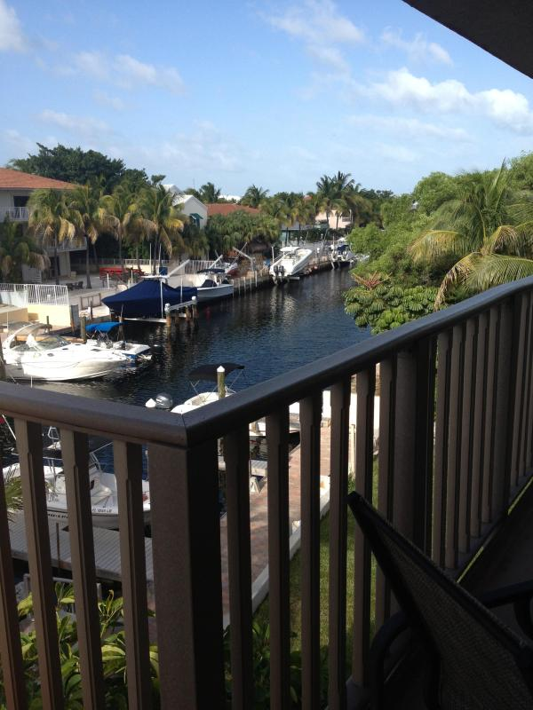 View from large balcony with dining and grill - Diver & Boater Friendly 2BR/2BA Canal-Front Condo - Key Largo - rentals