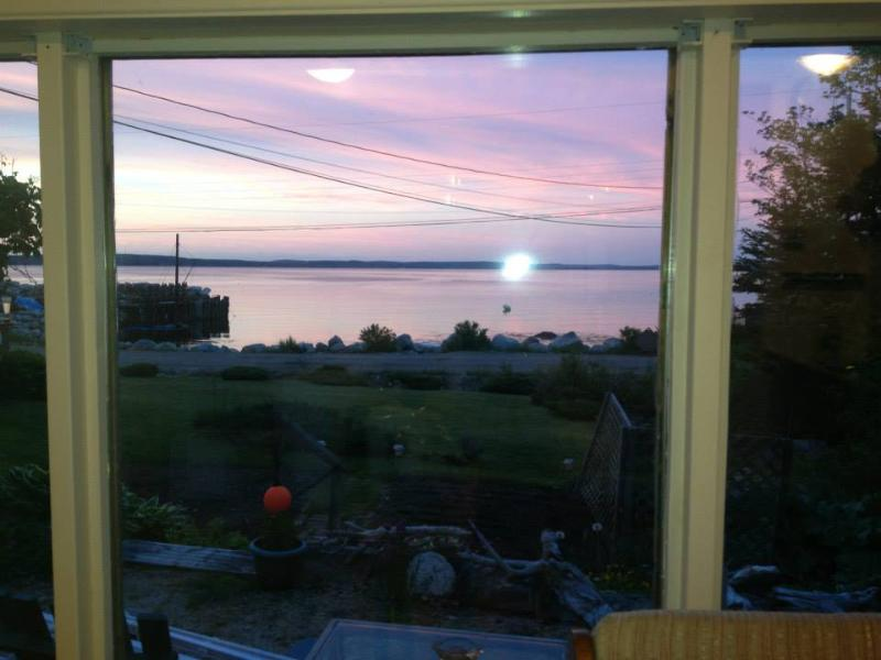 Reflecting Sunset from the table inside the cottage. - OCEANFRONT - Hubbards - rentals