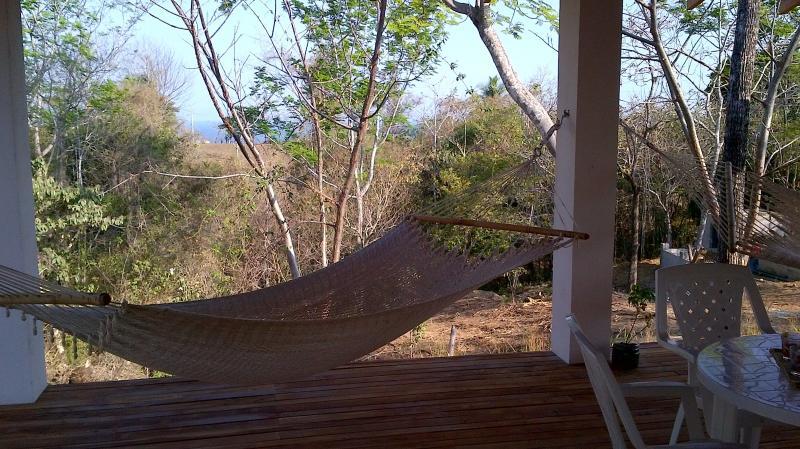 veranda with a bit of ocean view - Montezuma House 1 BR, A/C, veranda, 500 m to town - Montezuma - rentals