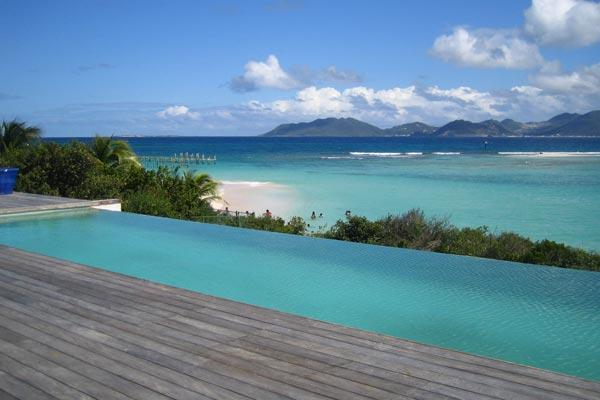 Located on Sandy Point Beach, this new villa incorporates traditional aspects of French West Indies architecture. RIC SHU - Image 1 - Saint Martin-Sint Maarten - rentals