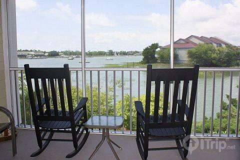 Screened porch for relaxing and catching the breeze - Turn of River 1-F - Folly Beach - rentals