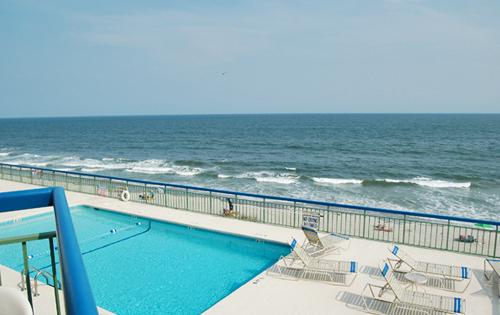 Your oceanfront balcony overlooks the 4th floor pool - Immaculate oceanfront 1BR @ The Oceans, WiFi/HDTV! - North Myrtle Beach - rentals
