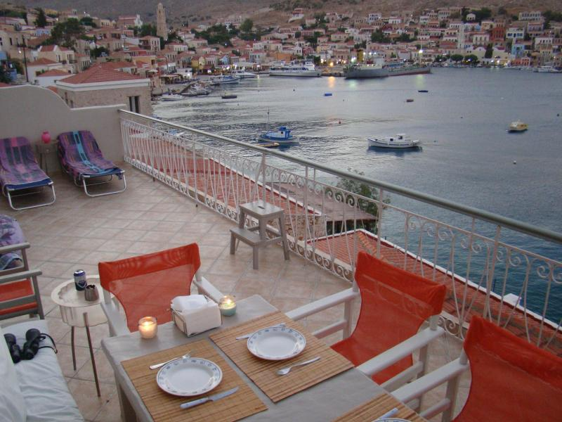 The balcony and the view to the village - Polyxeni's Sea front Villa - Halki - rentals