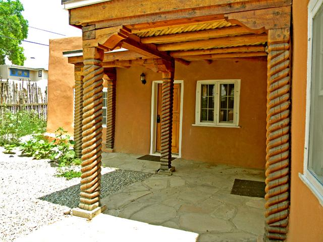 Traditional Taos spiral posts hole up the
