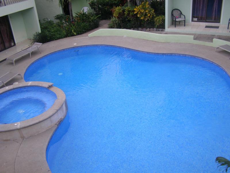 Out door pool from up stairs - Villa Riviera Condominium C6 - Playas del Coco - rentals