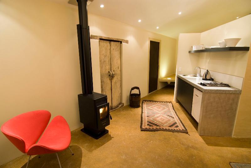 Wood heater and kitchen - Indigo Bush Studios Upper studio - Coromandel - rentals