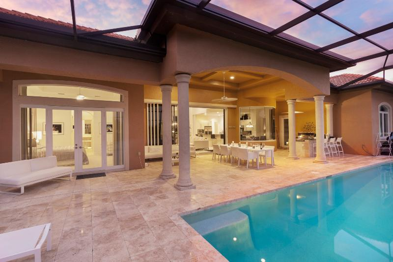 Our private lanai with lounge chairs, dining table for 8, professional ourdoor kitchen - One Of Kind Brand New Luxury Home At Naples - Just Listed - Naples - rentals