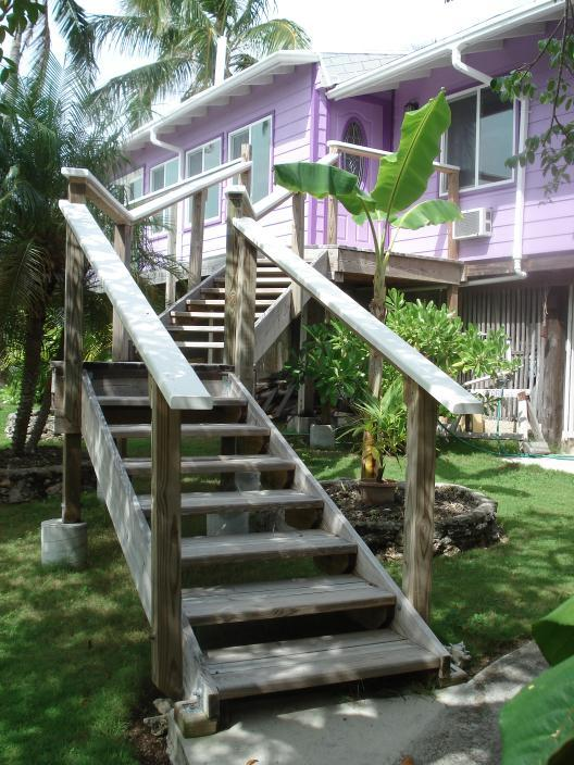 Front stairs to front door and front walkway. Note small-elevated stair steps -- easy to walk up - Elbow Cay, Abaco near Tahiti beach - Hope Town - rentals