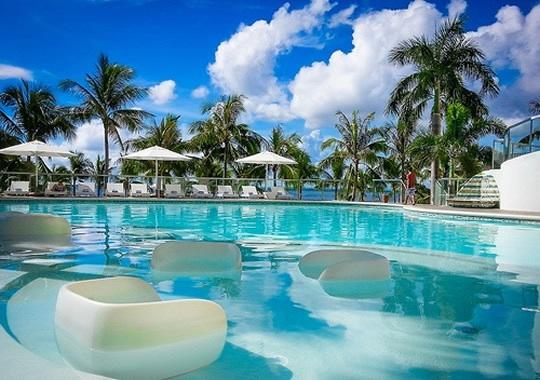 Modern Swimming Pool in the midst of Palm Trees and right by the Beach - MOVENPICK 1BR LUXURY OCEAN FRONT CONDO IN CEBU - Lapu Lapu - rentals