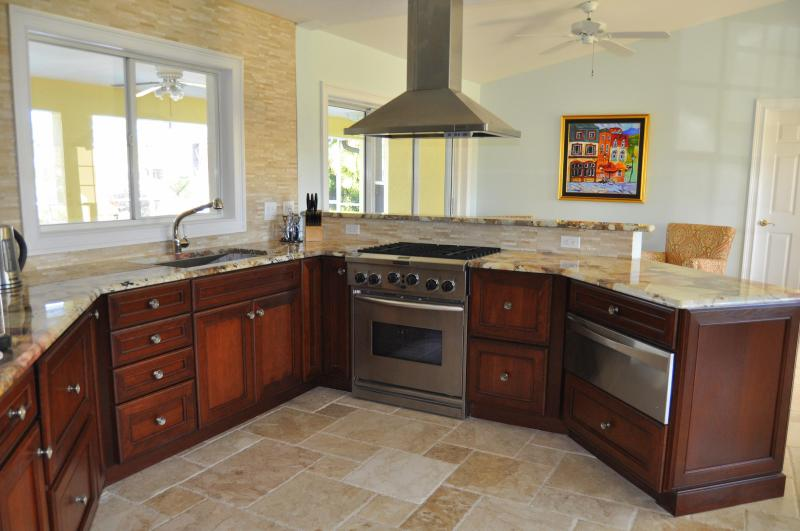 Inside enjoy a very modern kitchen - Exceptional Gulf Access Luxury Pool (Heated) Home - Cape Coral - rentals