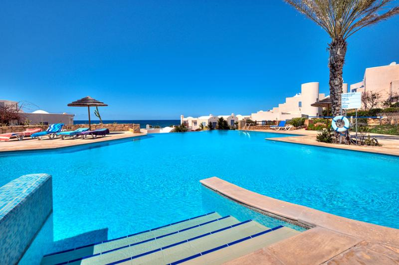 Go for a swim and lie down around the infinity pool whilst gazing out to sea. - Paphos Beach Villa with pool and sea view - Paphos - rentals