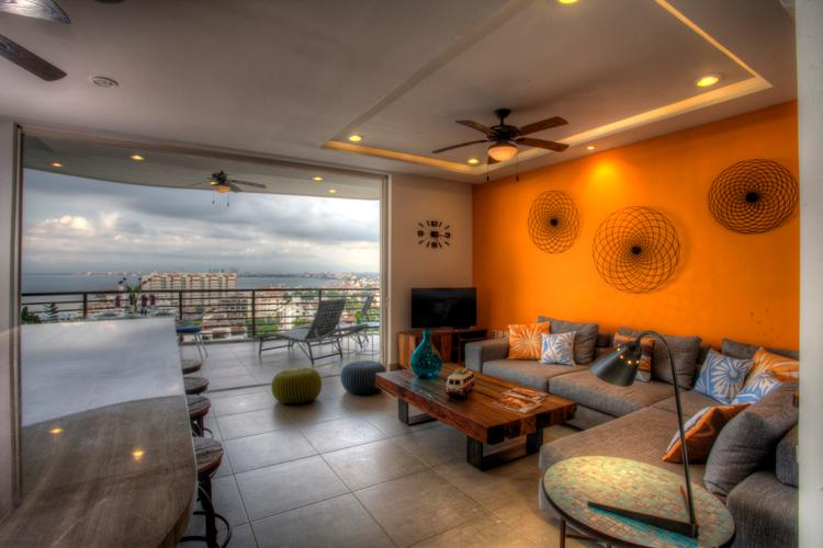 Light & bright open living area with outstanding views of the ocean and old town PV - SIGNATURE BY PINNACLE CORNER 2BD/2BA VIEW CONDO - Puerto Vallarta - rentals