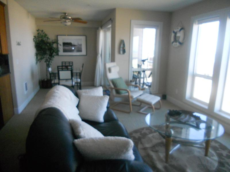 Living Room, Dining & Kitchen with Ocean View - Great Ocean Front View Condominium Rockaway Beach! - Rockaway Beach - rentals