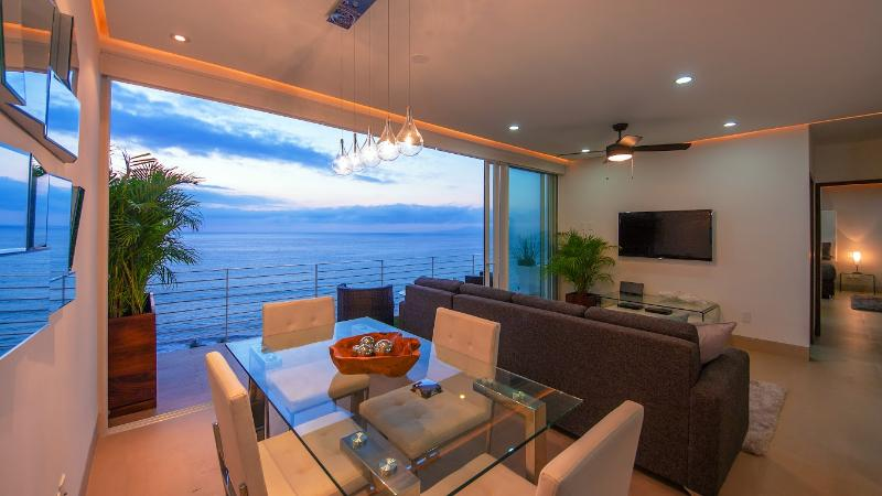 Views from every angle! Photo taken just after sunset! - PRIVATE DECK JACUZZI|ROOF INFINITY POOL|BLOCK2BEACH|AMAPAS353|FULLOCEAN VIEW|GYM - Puerto Vallarta - rentals