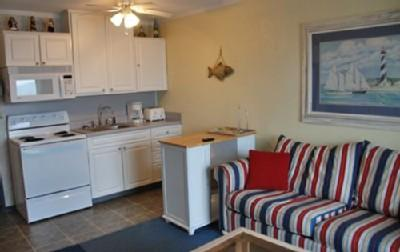 Living room and fully-equipped kitchen - Great Oceanfront View 1 Bedroom Rental at Myrtle Beach Resort A105 - Myrtle Beach - rentals
