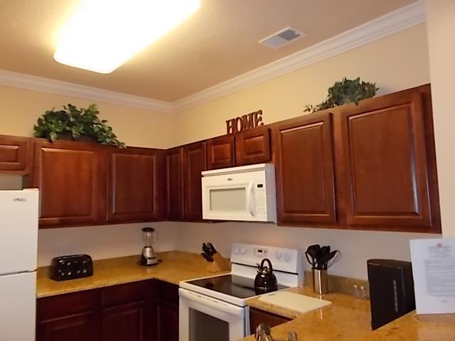 Kitchen with Granite CounterTops - Luxurious 2 Bed 2 Bath Condo Near Disney & More! - Davenport - rentals