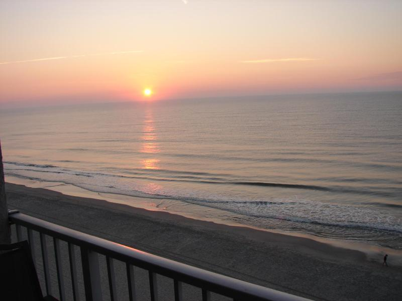View of sunrise off balcony - Awesome Oceanfront, Centrally Located, Shore Drive Condo with WiFi - Myrtle Beach - rentals