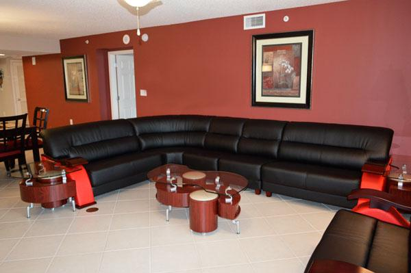 Breezy living room with huge leather sectional and HDTV - Huge 4BR Yacht Club condo, giant pool/WiFi - 2-704 - North Myrtle Beach - rentals