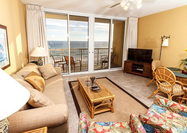 This beach front living room offers unforgettable views of the G - WE 507: BEACH SERVICE INCLUDED, FREE WI-FI, BEACH FRONT, AWESOME VIEWS - Fort Walton Beach - rentals