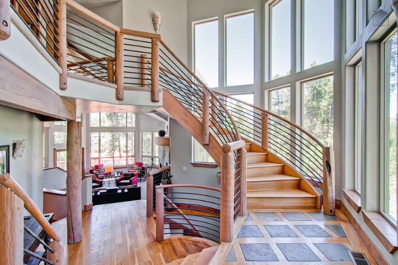The elegant staircase and natural light ensure that you always make a grand entrance. - Elegant, modern mountain home with hot tub, private theater, and game room (amazing views, free shuttle) - Aspenglow Chalet - Breckenridge - rentals