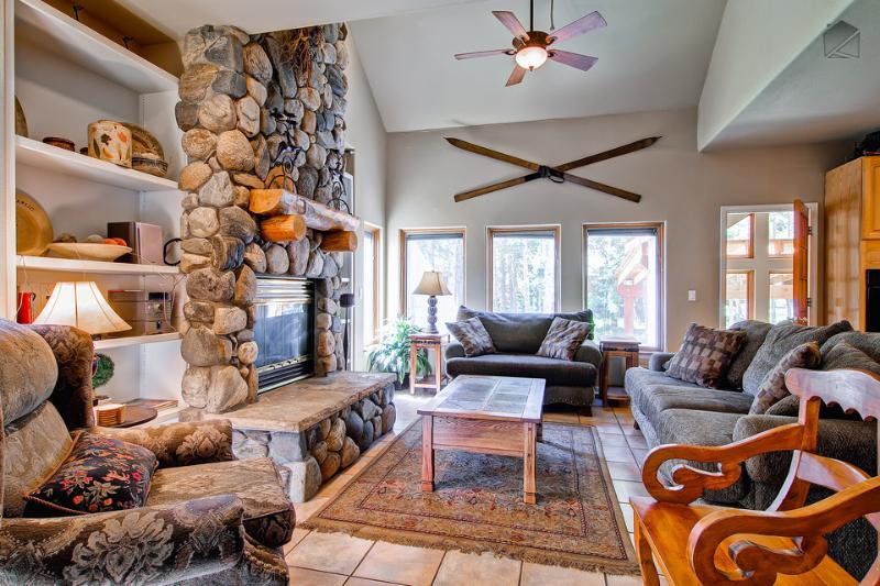 The great room features a soaring river rock fireplace, plenty of seating, stereo, and small library. - Expansive former chalet with private theater, game room, hot tub, and gazebo - Grand View Lodge - Breckenridge - rentals