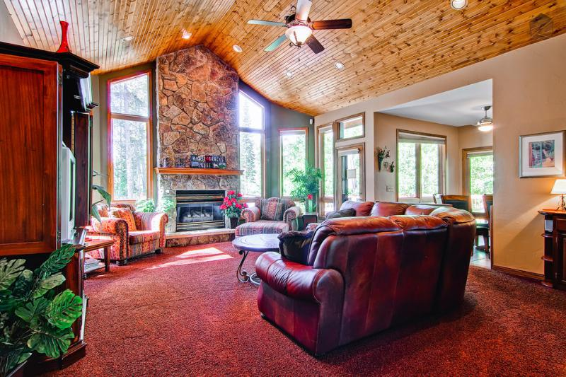 The wood ceiling and stone fireplace in the great room are illuminated by the large windows. - Beautiful wood furnished home, pet friendly, hot tub, fire pit, gondola parking passes  - Moose Tracks Lodge - Breckenridge - rentals