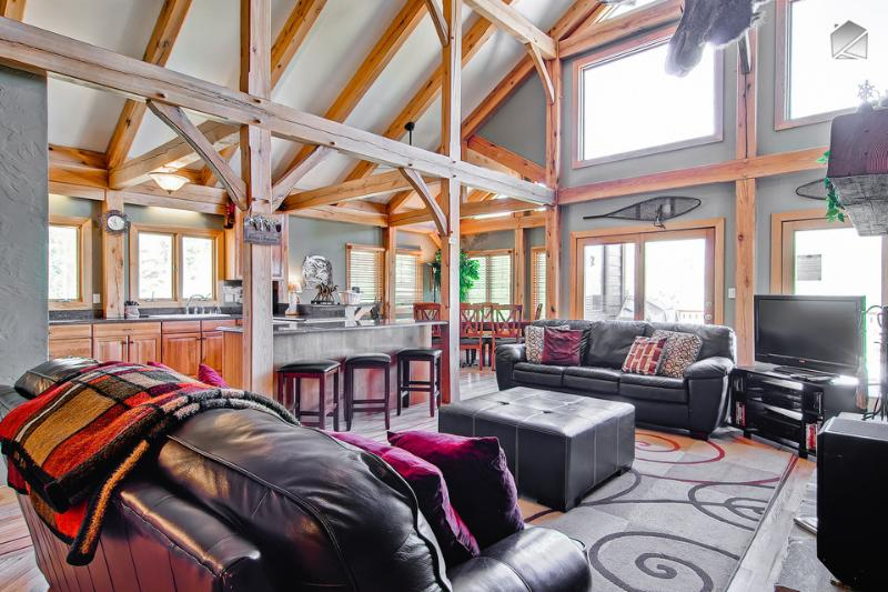 The open layout, wall of windows, and vaulted ceiling make this an inviting place to hang out. - Serene mountain home with pool table and gorgeous mountain views from the hot tub! (amazing views, game room) - Snow Mountain Lodge - Breckenridge - rentals