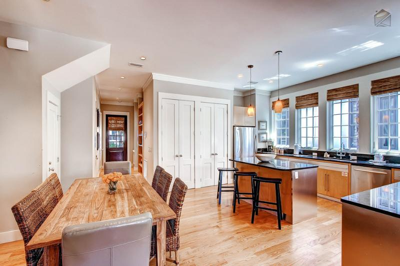 The dining area is adjacent to the kitchen and seats 6 - the island bar seats 3 more - Elegant home with beautiful private patio, shared pool and tennis courts, just a short walk to the beach - Derby Dunes - Rosemary Beach - rentals