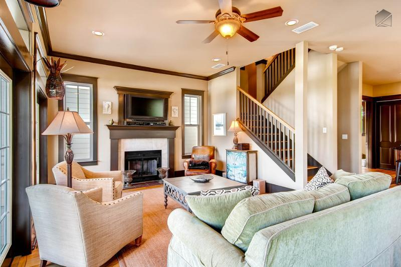 Large open living/dining space with fireplace, flatscreen TV, and balcony - - Comfort and Joy - Seacrest Beach - rentals