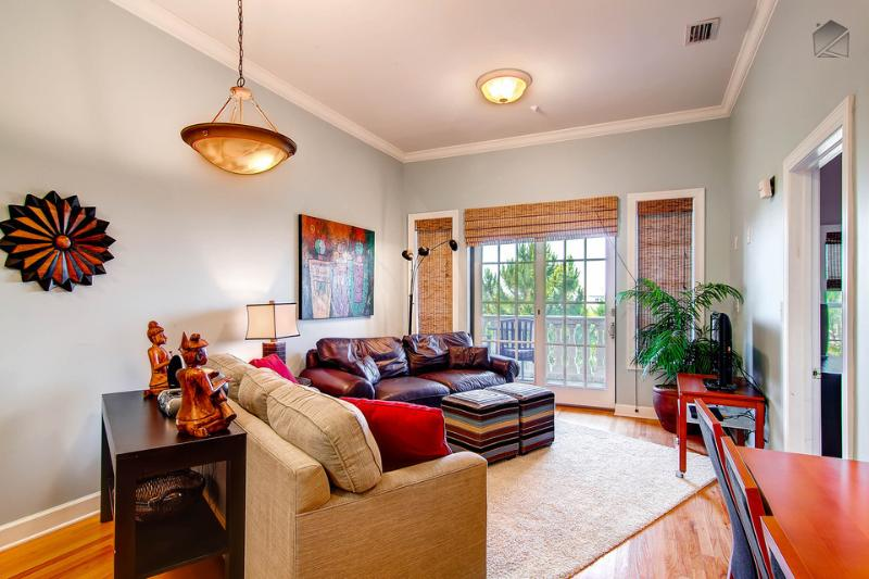 Another view of living area, which has hardwood floors and access to a balcony - Comfortable, stylish condo with private balcony, free shuttle, just minutes from the beach - The Magnolia - Seacrest Beach - rentals