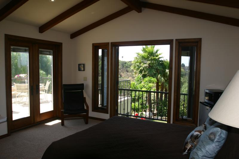 Two French Doors Leading to Deck & Balcony. Blinds are inside the window panes. - Tropical Getaway With Views - Santa Barbara - rentals