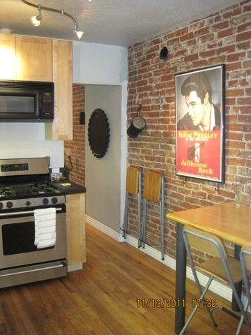 Contemporary kitchen combined with 1890s brick! - Walk to Best of Downtown & Lohi!  Cozy & Contemporary Townhome - Denver - rentals