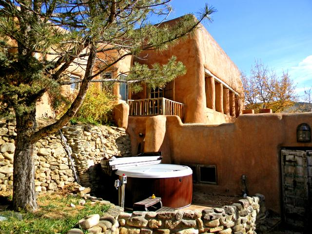 Private hot tub has access from all 3 units and is very private from outsiders - Adobe Hacienda - main house - Ranchos De Taos - rentals