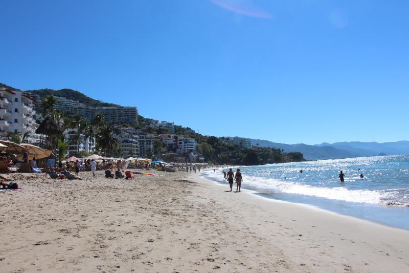 Walk 2 blocks to sit on Los Muertos Beach, relax and enjoy a Margarita - Zona Romantico 2 bedroom condo - Puerto Vallarta - rentals