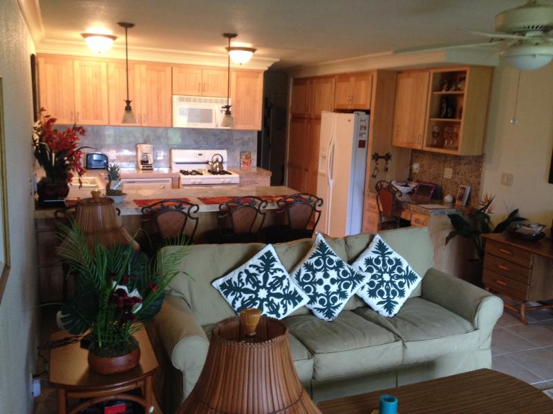 Living room, kitchen  couch facing outdoors  - C112 Wavecrest Retreat (GROUND FLOOR) - Kaunakakai - rentals