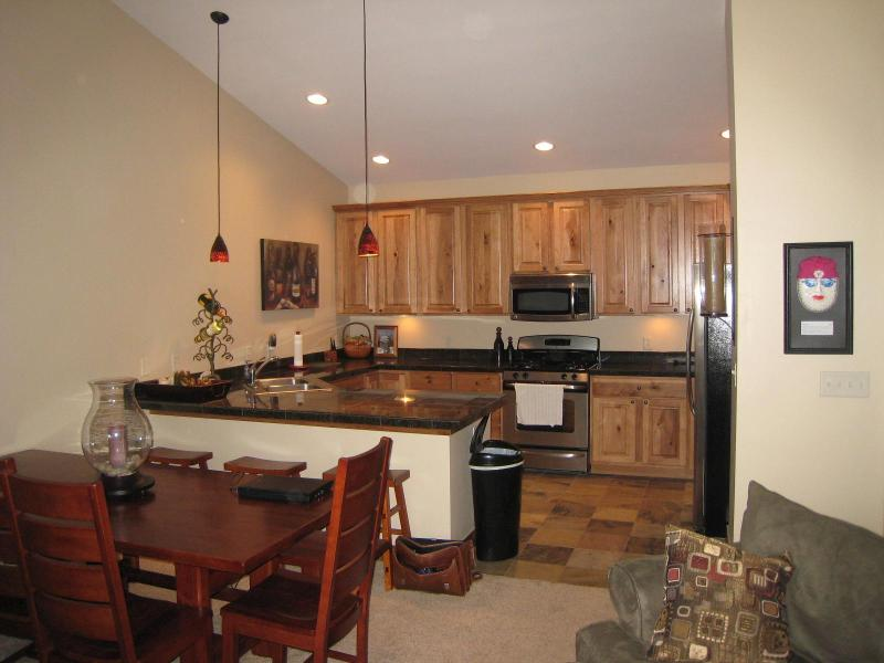 Kitchen - Beautiful, Upscale Condo.  Shuttle to Ski, Walk to Nightlife!! - Winter Park - rentals