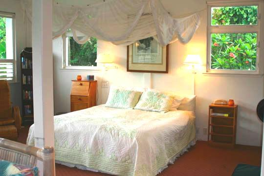 Romantic Honeymoon Bed with Fragrant Plumeria Flower Trees outside both bedside windows - Romantic Hanalei Honeymoon Vacation Rental - Hanalei - rentals
