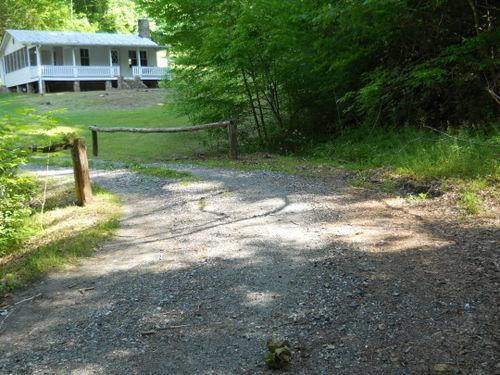 Through the tree-lined drive...across the creek... - Peaceful Farmhouse with Private Hiking Trails - Marshall - rentals