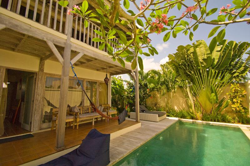 Relaxing next to the pool - Wooden Villa with Pool near Beach - Canggu - rentals