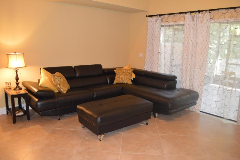 Living room - extends into lanai under roof - Villa at Waterfront Community (Club Med) - Port Saint Lucie - rentals