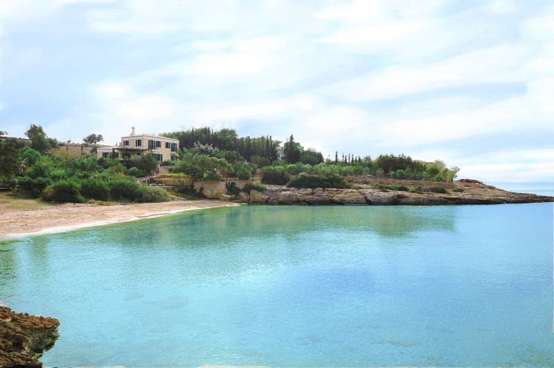 The villa as seen from the beach. - BEACHFRONT VILLA WITH TENNIS COURT - Port Heli - rentals